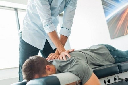 A patient receiving chiropractic care at our richmond hill clinic